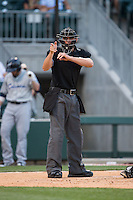 Home plate umpire Shane Livensparger makes a strike call during the International League game between the Columbus Clippers and the Charlotte Knights at BB&T BallPark on May 27, 2015 in Charlotte, North Carolina.  The Clippers defeated the Knights 9-3.  (Brian Westerholt/Four Seam Images)