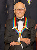 Norman Lear, one of he five recipients of the 40th Annual Kennedy Center Honors with his award as he poses for a group photo following a dinner hosted by United States Secretary of State Rex Tillerson in their honor at the US Department of State in Washington, D.C. on Saturday, December 2, 2017. The 2017 honorees are: American dancer and choreographer Carmen de Lavallade; Cuban American singer-songwriter and actress Gloria Estefan; American hip hop artist and entertainment icon LL COOL J; American television writer and producer Norman Lear; and American musician and record producer Lionel Richie.  <br /> Credit: Ron Sachs / Pool via CNP