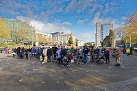 Pictured: Members of the public, members of the armed forces and veterans gather at Castle Square Gardens in Swansea, Wales, UK. Monday 11 November 2019<br /> Re: Armistice Day, a service to commemorate those who lost their lives in conflict has been held at Castle Square Gardens in Swansea, Wales, UK.