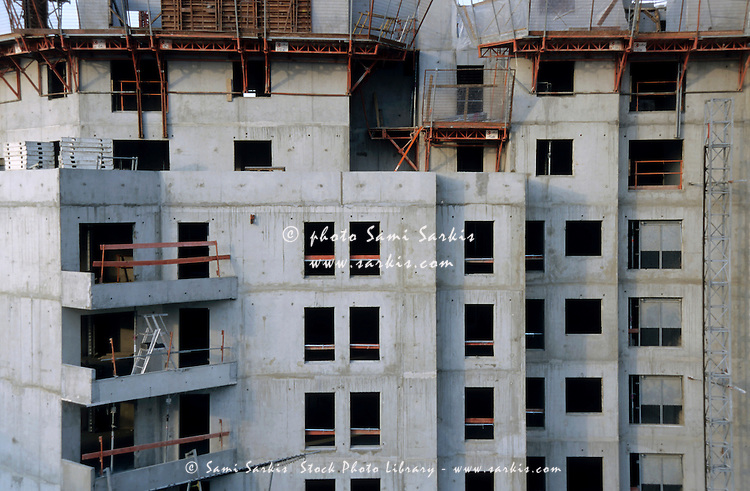 Facade of an apartment building under construction in the Courbevoie suburb of Paris, France.
