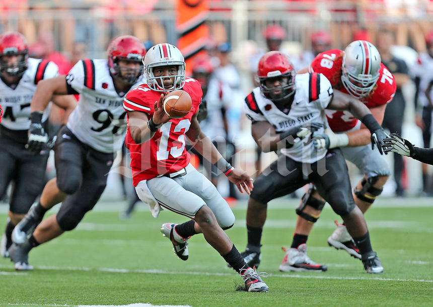 Ohio State Buckeyes quarterback Kenny Guiton (13) in action during a football game between the Ohio State Buckeyes and the San Diego State Aztecs on Sept. 7, 2013 at Ohio Stadium. (Columbus Dispatch photo by Fred Squillante)
