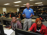 NWA Democrat-Gazette/FLIP PUTTHOFF<br /> Teacher Jay Gilstrap works with Rogers Heritage High School students Sergio Juan (left) and Jocelyn Moran during Project Lead The Way on Tuesday April 18 2015 at the school.