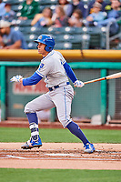 Garin Cecchini (7) of the Omaha Storm Chasers follows through on his swing against the Salt Lake Bees in Pacific Coast League action at Smith's Ballpark on May 8, 2017 in Salt Lake City, Utah. Salt Lake defeated Omaha 5-3. (Stephen Smith/Four Seam Images)