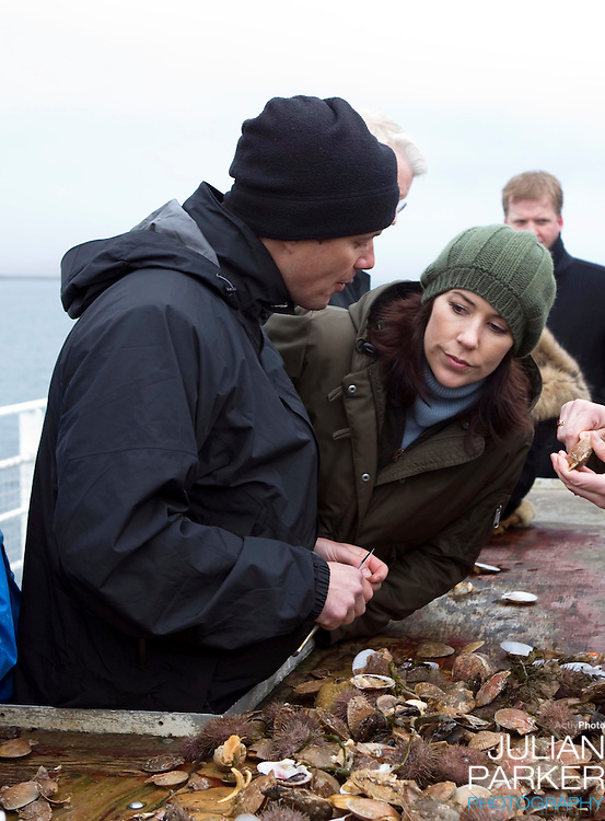 Crown Prince Frederick and Crown Princess Mary of Denmark on a four day official visit to Iceland,take boat trip from Stykkisholms Harbour, and view wildlife including whales, and sample freshly caught seafood