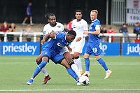 Marc-Anthony Okoye of Bromley tries to tackle Chesterfield's Mike Fondop during Bromley vs Chesterfield, Vanarama National League Football at the H2T Group Stadium on 7th September 2019