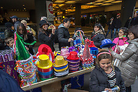"Crowds buy paraphernalia in Times Square in New York on Monday, December 31, 2012, the afternoon of New Year's Eve. Temperatures for the celebration are expected to drop below freezing but remain dry with over a million people packing the ""Crossroads of the World"" celebrating the incoming 2013. (© Richard B. Levine)"