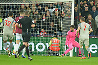 Alisson Becker of Liverpool watches the ball slip past him from Michail Antonio of West Ham United scores the second Goal and celebrates during West Ham United vs Liverpool, Premier League Football at The London Stadium on 4th February 2019