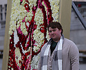 "Pic shows: Flower artist Joseph Massie with his picture of Wills and Kate Middleton in traflagar Sq today 13.2.13..On the day that Italian and Ausssie magazines announce they will publish shots of bikini clad Kate Middleton pregnant - Kate is seen ""blooming"" in trafalgar square - Asda partners with RHS Chelsea winner, Joseph Massie, to create floral portrait of the Duke and Duchess of Cambridge. Massie's artwork stands 8.8ft tall by 6.6ft wide and was created using a combination of 1,830 flowers. Outside the National Gallery in Trafalgar Square.....Pic by Gavin Rodgers/Pixel 8000 Ltd"