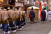 Men carrying a palanquin, possibly with a deity inside, in the Tenjin Festival in Osaka.