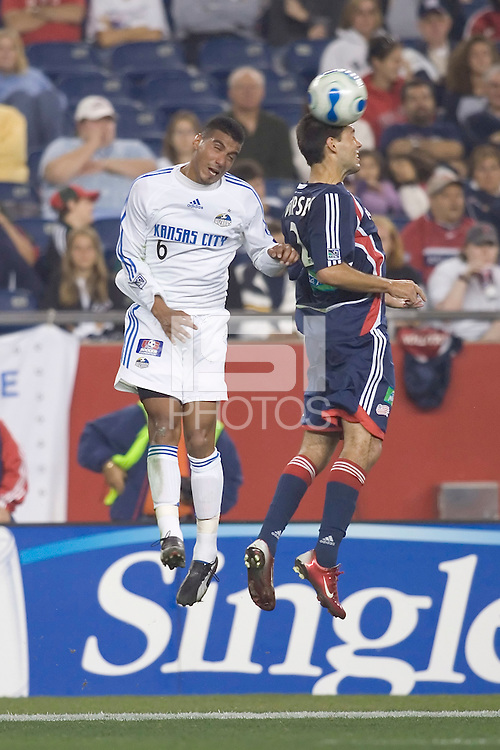 Jose Luis Burciaga Jr. (KC Wizards, white) and Clint Dempsey (NE Revolution, blue) go for a head ball. NE Revolution tied KC Wizards, 1-1, at Gillette Stadium.