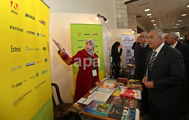 Palestinian Pime Minister, Salam Fayyad attends the opening ceremony of the Palestinian ICT Exhibition at Birzeit University in the West Bank city of Ramallah on April 5, 2011. Photo by Mustafa Abu Dayeh