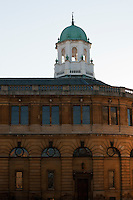 Oxford's Sheldonian Theatre in bright late afternoon light that makes the sandstone glow.