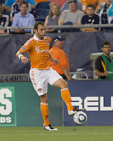 Houston Dynamo midfielder Brad Davis (11) controls the ball. In a Major League Soccer (MLS) match, the New England Revolution tied Houston Dynamo, 1-1, at Gillette Stadium on August 17, 2011.