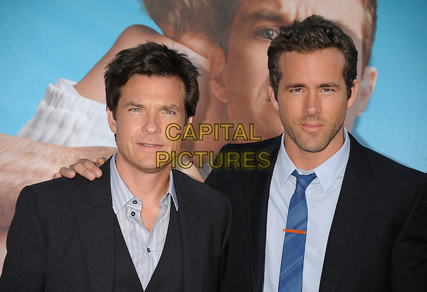 "Jason Bateman and Ryan Reynolds.The Los Angeles premiere of ""The Change-Up"" at Regency Village Theatre in Westwood, California, USA..August 1st, 2011.headshot portrait stubble facial hair blue black suit shirt tie  .CAP/ROT/TM.©Tony Michaels/Roth Stock/Capital Pictures"
