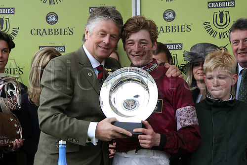 09.04.2016. Aintree, Liverpool, England. Crabbies Grand National Festival Day 3. Grand National Winning jockey David Mullins is presented with the Crabbies trophy.