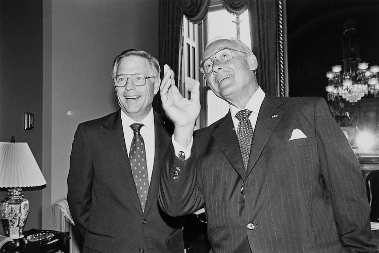 Rep. Thomas W. Ewing, R-Ill. and Robert H. Michel, R-Ill, at the mock swear in.  Robert H. Michel, R-Ill, tells Rep. Thomas W. Ewing, R-Ill. that Washington press likes to shoots photos up member's noses and catch their bald spots. July 8, 1991. (Photo by Laura Patterson/CQ Roll Call)