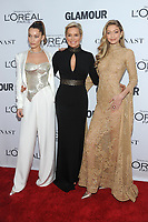 BROOKLYN, NY - NOVEMBER 13: Bella Hadid, Yolanda Hadid and Gigi Hadid  at Glamour's 2017 Women Of The Year Awards at the Kings Theater in Brooklyn, New York City on November 13, 2017. Credit: John Palmer/MediaPunch