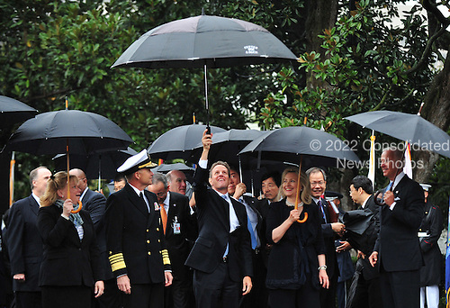 United States Secretary of the Treasury Timothy Geithner jokingly holds up his umbrella at the arrival ceremony for President Lee Myung-bak of South Korea on the South Lawn at the White House in Washington, D.C. on Thursday, October 13, 2011.  .Credit: Kevin Dietsch / Pool via CNP
