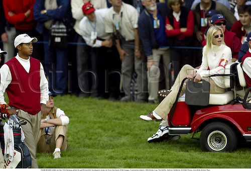 TIGER WOODS (USA) on the 15th fairway while his girlfriend Elin Nordegren looks on from the back of the buggy, Foursomes Match, 34th Ryder Cup, The Belfry, Sutton Coldfield, 020928. Photo: Glyn Kirk/Action Plus....2002.golf golfer player