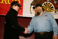 Tollof Monson (left) recieves the sportsmanship award from race Marshall Mark Nordman at the Nome awards banquet.
