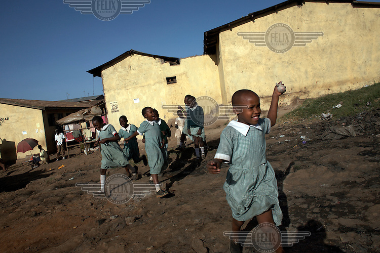 School girls playing in Korogocho, the third largest slum in Nairobi.