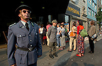 Two fake VOPO's (the infamous East German soldiers) stand beside a recreation of the Berlin Wall outside   the Imperial Cinema  in Montreal, CANADA,  <br /> Where the Movie `` The Tunnel `` (Der Tunnel) is beeing shown in the World Film Festival Competition, August 31, 2001<br /> <br /> The movie directed by Roland Suso Richter tell the story of East-Germans who dug a tunnel uner the Berlin Wall.<br /> <br /> Photo by Pierre Roussel /Getty News Images Service (ON SPEC)<br /> <br /> NOTE : raw jpeg from Nikon D 1, openened with QUIMAGE ICC profile