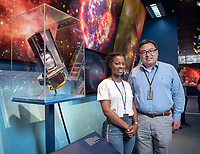 With Dr. Renyu Hu, a planetary scientist interested in the atmosphere, evolution, and habitability of planets in the Solar System and exoplanets. <br /> Model of the Spitzer Space Telescope.<br /> Occidental College student Tre'Shunda James '19 is a Jet Propulsion Laboratory Research Intern at NASA's JPL in Pasadena. Tre'Shunda is working with Dr. Renyu Hu studying oxygen in terrestrial exoplanet atmospheres and is also working on a project for the Undergraduate Research Center's Summer Research Program.<br /> Photo taken July 12, 2018.<br /> (Photo by Marc Campos, Occidental College Photographer)