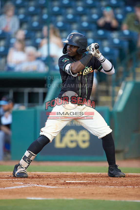 Rodolfo Castro (7) of the Ocelotes de Greensboro at bat against the Hickory Crawdads at First National Bank Field on June 11, 2019 in Greensboro, North Carolina. The Crawdads defeated the Ocelotes 2-1. (Brian Westerholt/Four Seam Images)