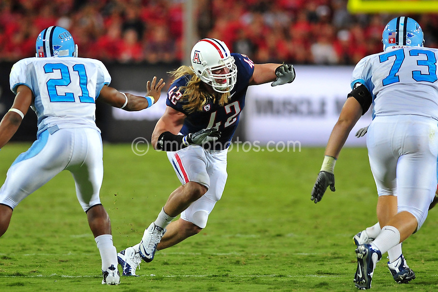 Sept 11, 2010; Tucson, AZ, USA; Arizona Wildcats defensive end Brooks Reed (42) prepares to engage a Citadel Bulldogs offensive lineman in the 1st half of a game at Arizona Stadium.  Arizona won the game 52-6.