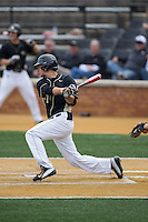 Bruce Steel (17) of the Wake Forest Demon Deacons follows through on his swing against the Miami Hurricanes at Wake Forest Baseball Park on March 22, 2015 in Winston-Salem, North Carolina.  The Demon Deacons defeated the Hurricanes 10-4.  (Brian Westerholt/Four Seam Images)