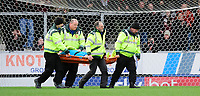 Blackpool's Mark Howard is carried off the pitch on a stretcher after suffering an injury<br /> <br /> Photographer Chris Vaughan/CameraSport<br /> <br /> The EFL Sky Bet League One - Burton Albion v Blackpool - Saturday 16th March 2019 - Pirelli Stadium - Burton upon Trent<br /> <br /> World Copyright &copy; 2019 CameraSport. All rights reserved. 43 Linden Ave. Countesthorpe. Leicester. England. LE8 5PG - Tel: +44 (0) 116 277 4147 - admin@camerasport.com - www.camerasport.com