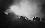 """5Feb1953 ..Harrassing Fire -- Tank from """"Dog"""" Company, 1st Tank Battalion, cut with their 90mm guns during the night firing, """"Harrassing and indirect"""" fire at enemy position in front of the First Marine Division sector on the Western Front."""