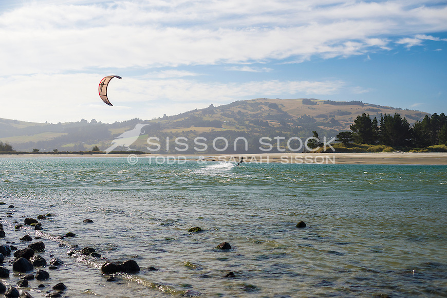Kite surfer in the wind, off the beach at Doctors Point, Dunedin, South Island, New Zealand - stock photo, canvas, fine art print