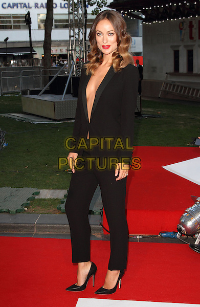 Olivia Wilde<br /> The World Premiere of 'Rush' at the Odeon Leicester Square, London, England.<br /> September 2nd, 2013<br /> full length black trousers blazer suit plunging neckline cleavage  <br /> CAP/ROS<br /> &copy;Steve Ross/Capital Pictures