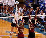 BROOKINGS, SD - OCTOBER 3:  Kacey Herrmann #3 from South Dakota State University tips the ball against the defense of Sarah Schmid #3 and Nikki Kennedy #12 from Denver in the fourth game of their match Friday night at Frost Arena. (Photo/Dave Eggen/Inertia)