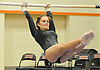 Kaleigh Pensevalle of Lindenhurst performs on the uneven bars during the Suffolk County varsity girls' gymnastics individual championships at Babylon High School on Friday, November 6, 2015.<br /> <br /> James Escher