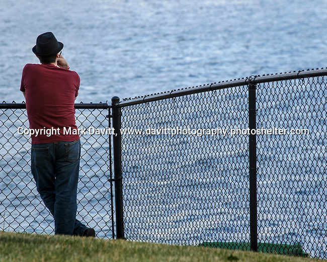 Pleasant Hill held its first of the summer Chill on the Hill June 23 at Copper Creek Lake. Nathan Luethje of Indianola chills as he looks out over the lake.