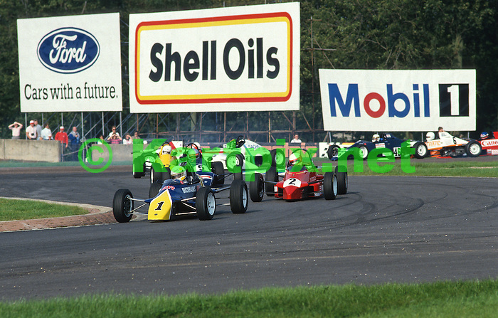 Eddie Irvine leads the pack in his works Duckhams RF87 with his season long rival Alain Menu next up. Jonathan McGall's Mondiale and Richard Dean's Swift are just clear of a spinning Takuya Kurosawa with Vivion Daly close by Allan McNish, Julian Westwood and Kozo Orita complete the shot.