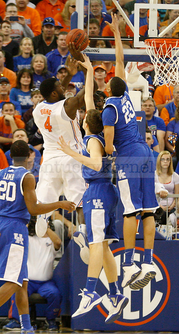 UK forwards Kyle Wiltjer and Anthony Davis attempt to block Florida's Patric Young's shot during the first half of the University of Kentucky's men basketball game against University of Florida 3/4/12 at the O'Connell Center in Gainesville, Fl. Photo by Quianna Lige | Staff