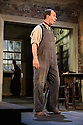 London, UK. 26.07.2016. THE PLOUGH AND THE STARS opens at the National Theatre. Directed by Howard Davies and Jeremy Herrin, with design by Vicki Mortimer. Picture shows: Tom Vaughan-Lawlor (The Covey). Photograph © Jane Hobson.