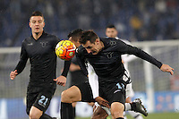 Calcio, quarti di finale di Coppa Italia: Lazio vs Juventus. Roma, stadio Olimpico, 20 gennaio 2016.<br /> Juventus' Alex Sandro and Lazio's Miroslav Klose, right, fight for the ball during the Italian Cup quarter final football match between Lazio and Juventus at Rome's Olympic stadium, 20 January 2016.<br /> UPDATE IMAGES PRESS/Isabella Bonotto