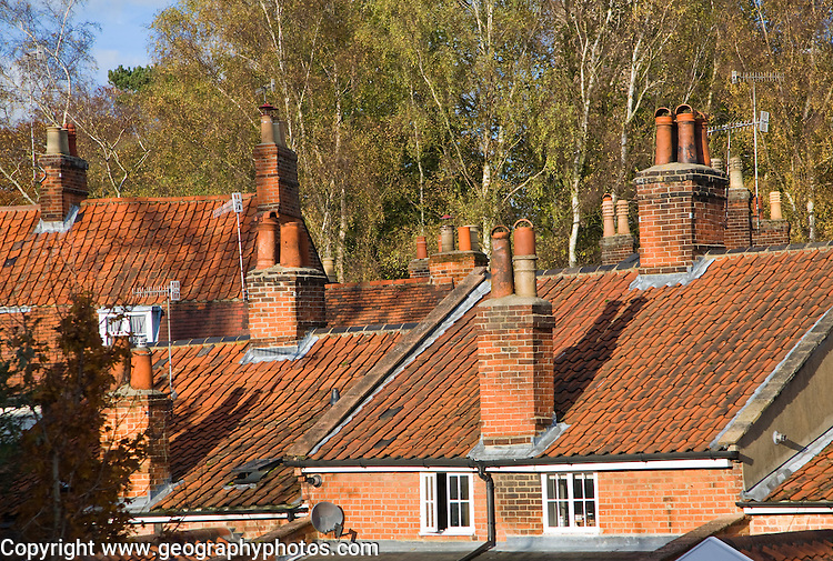 Pan-tiled roofs and chimneys on traditional housing in Woodbridge, Suffolk, England