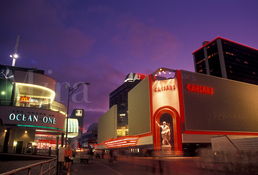 AJ4331, casino, Atlantic City, boardwalk, Caesars, New Jersey, Caesars Casino Hotel on the boardwalk in Atlantic City illuminated at night in the state of New Jersey.