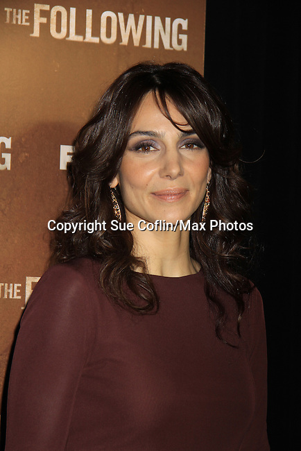 "As The World Turns' Annie Parisse ""Julia"" stars as FBI Agent ""Debra Parker""  in ""The Following"", Fox's new tv series on Mondays, which held its world premiere on January 19, 2013 at the New York Public Library, New York City, New York. (Photo by Sue Coflin/Max Photos)"