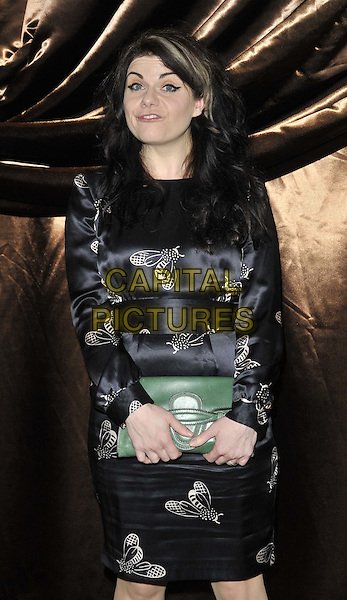 Caitlin Moran.The Galaxy National Book Awards 2011, Mandarin Oriental Hyde Park hotel, Knightsbridge, London, England..November 5th, 2011.full length black dress bees white print green clutch bag  .CAP/CAN.©Can Nguyen/Capital Pictures.