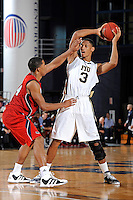 21 January 2012:  FIU guard-forward Dominique Ferguson (3) handles the ball while being defended by FAU guard-forward Kelvin Penn (44) in the second half as the Florida Atlantic University Owls defeated the FIU Golden Panthers, 66-64, at the U.S. Century Bank Arena in Miami, Florida.