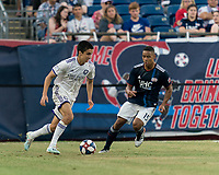 FOXBOROUGH, MA - JULY 27: Joao Moutinho #44 dribbles as Brandon Bye #15 defends during a game between Orlando City SC and New England Revolution at Gillette Stadium on July 27, 2019 in Foxborough, Massachusetts.