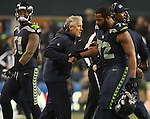 Seattle Seahawks  head coach Pete Carroll greets defensive end Michael Bennett (72) after the defensive unit held the Carolina Panthers from making a crucial first down in the NFC Western Division Playoffs at CenturyLink Field  on January 10, 2015 in Seattle, Washington. The Seahawks beat the Panthers 31-17. ©2015. Jim Bryant Photo. All Rights Reserved.