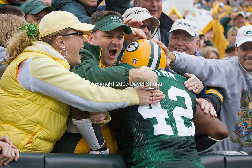 Running back  DeShawn Wynn #42 of the Green Bay Packers celebrates his 3 yard touchdown run with a Lambeau Leap during an NFL football game against the Washington Redskins at Lambeau Field on October 14, 2007 in Green Bay, Wisconsin. The Packers beat the Redskins 17-14. (Photo by David Stluka)