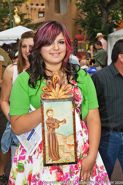 The Santa Fe Spanish Market, held in July, fills the Santa Fe Plaza with artists parton and visitors all celebrating traditional Spanish colonial arts. It is held side by side with the Contemporary Spanish Market which features modern Hispanic artists. Many artists march in the Sunday Procession.